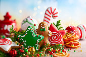istock Festive concept with Christmas gingerbread in the shape of a star, fir branches and winter spices. 1174662164