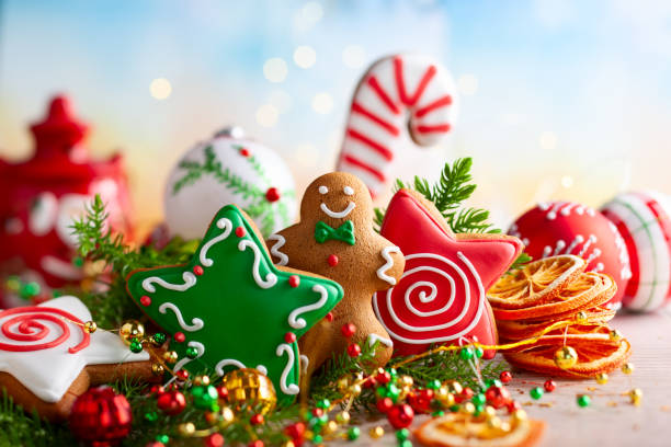 festive concept with christmas gingerbread in the shape of a star, fir branches and winter spices. - christmas cookies imagens e fotografias de stock