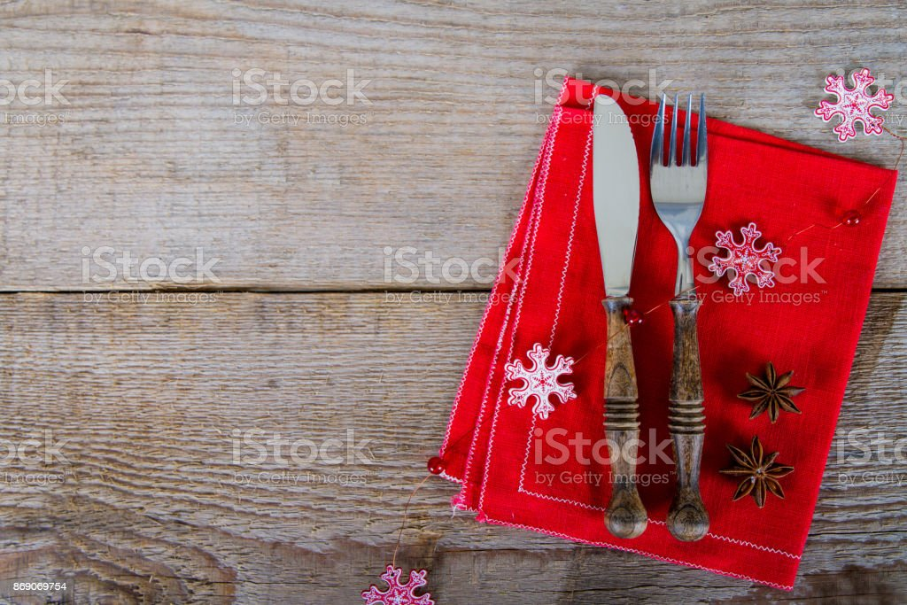 Festive cutlery on the red napkin stock photo