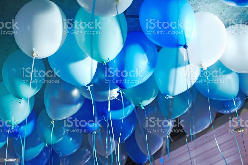 Festive decorated selling with blue tone helium balloons, birthday party стоковое фото