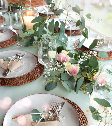 Festive decorated wedding table for celebration with short depth of field