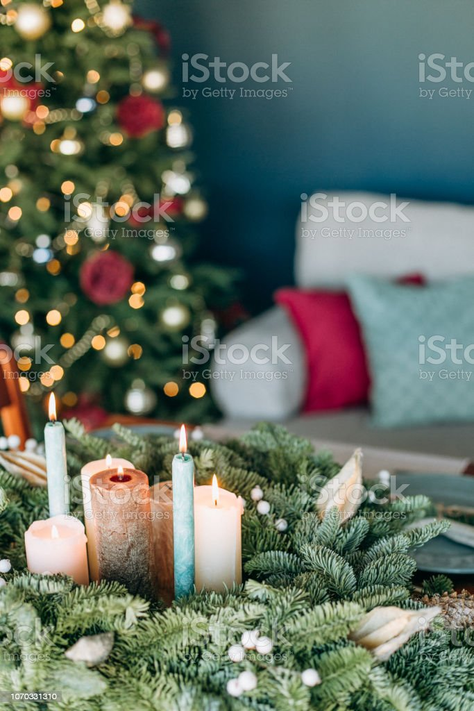 festive decorations and table setting inside the room with the...