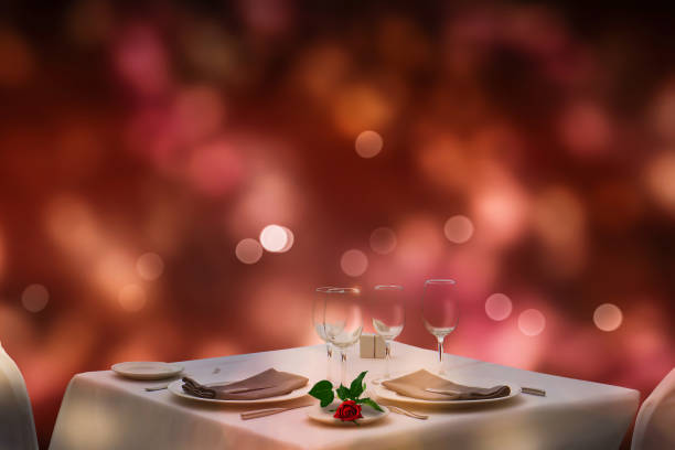 festive dinner arrangement at valentines day festive dinner arrangement at valentines day on blurred background date night romance stock pictures, royalty-free photos & images