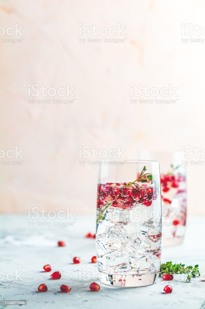 Festive drinks, gin and tonic pomegranate cocktail stock photo