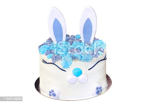 Festive Easter white cake in the shape of a hare for decoration and decoration on an isolated white background