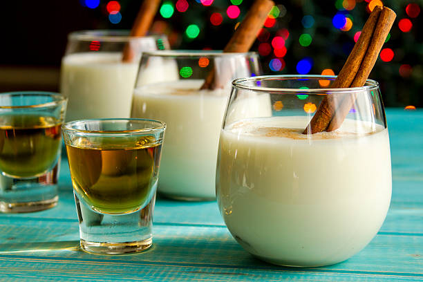 Festive Egg Nog with Cinnamon and Cookies stock photo