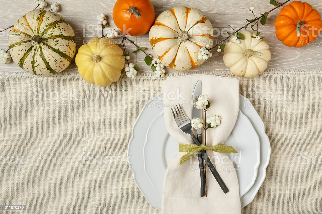 Festive fall table setting place setting home decorations with pumpkins stock photo