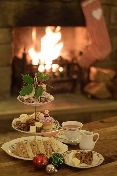 festive fireside afternoon tea - eftermiddagste bildbanksfoton och bilder