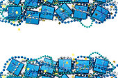 istock Festive frame of blue shiny gift boxes, blue beads and golden confetti stars 878753972