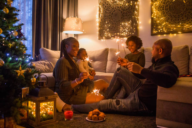 Festive fun for a beautiful Black family at Christmas stock photo