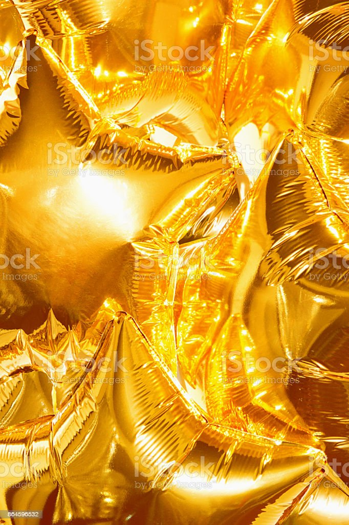 festive gold star balls completely filled the background stock photo