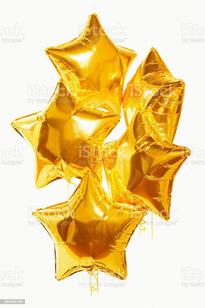 festive golden star balls on white background stock photo