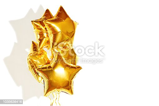 1035635902 istock photo festive golden stars balls on white background 1035636416