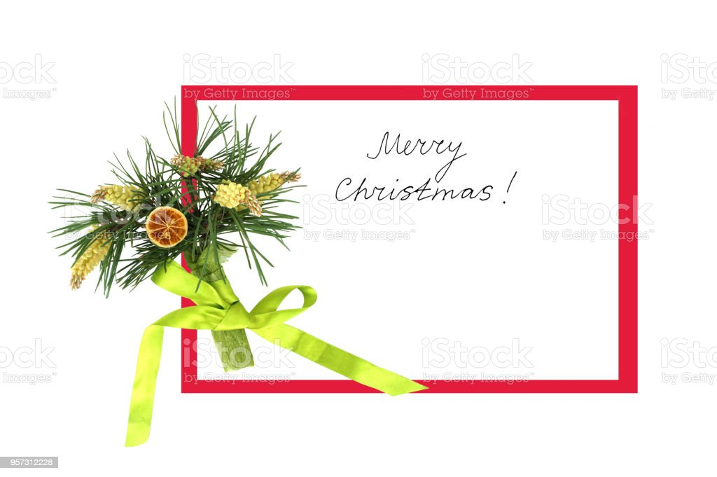 Festive greeting card with pine branch with cones and a handwritten inscription 'Merry Christmas'. handmade. stock photo