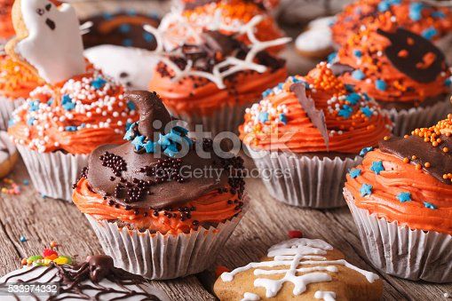 istock festive Halloween cupcakes close-up on the table. horizontal 533974332