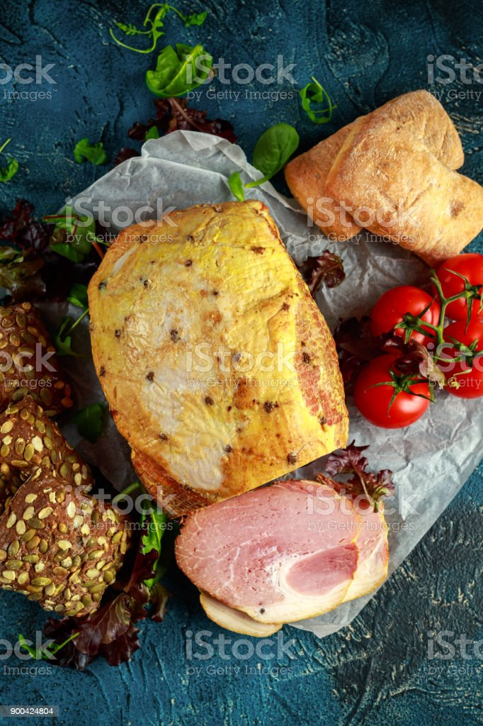 Festive ham served with tomatoes and rustic bread stock photo