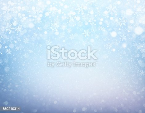 Snowflakes and snowfall on a frozen blue background - Winter material