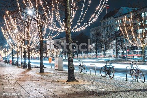 istock festive illuminated trees in shopping street unter den Linden at blue hour in Berlin 1290315698