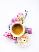 istock Festive invitation card with beautiful flowers and cup of coffee 930975276