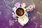 istock Festive invitation card with beautiful flowers and cup of coffee 930984960