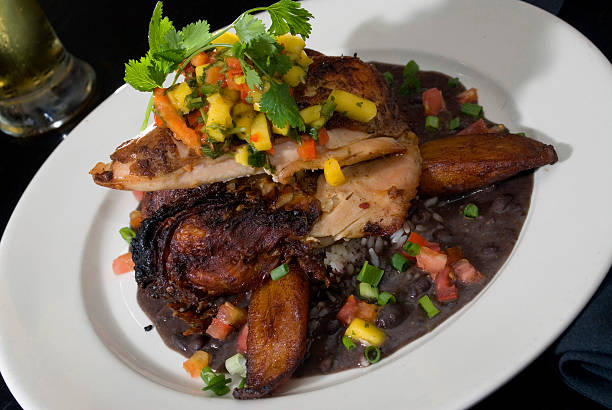 festive jerk chicken - caribbean food stock photos and pictures