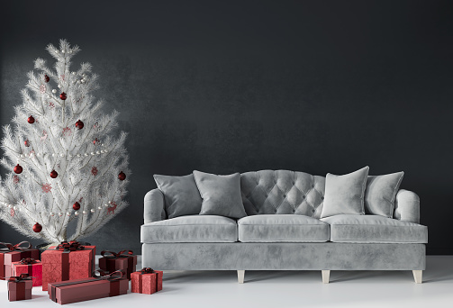 Festive Living Room With A Luxurious Sofa And A White Christmas Tree With Red Gifts Stock Photo - Download Image Now
