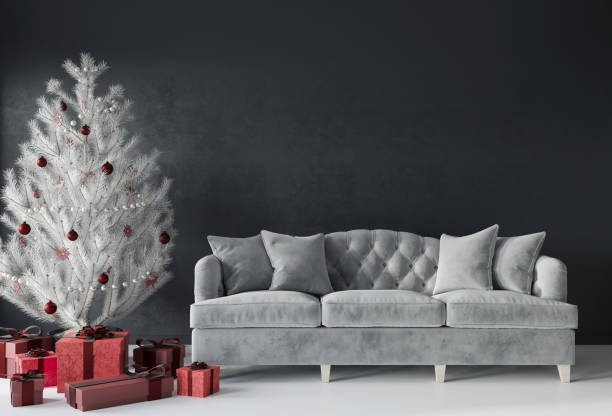 Festive living room with a luxurious sofa and a white Christmas tree with red gifts