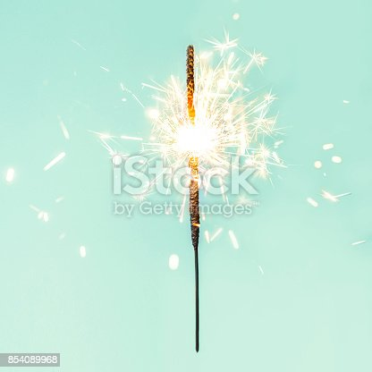 istock Festive Merry Christmas sparklers. Golden Magic lights for holiday poster, birthday or party concept. Sparkling beautiful sparkles or  bengal lights 854089968