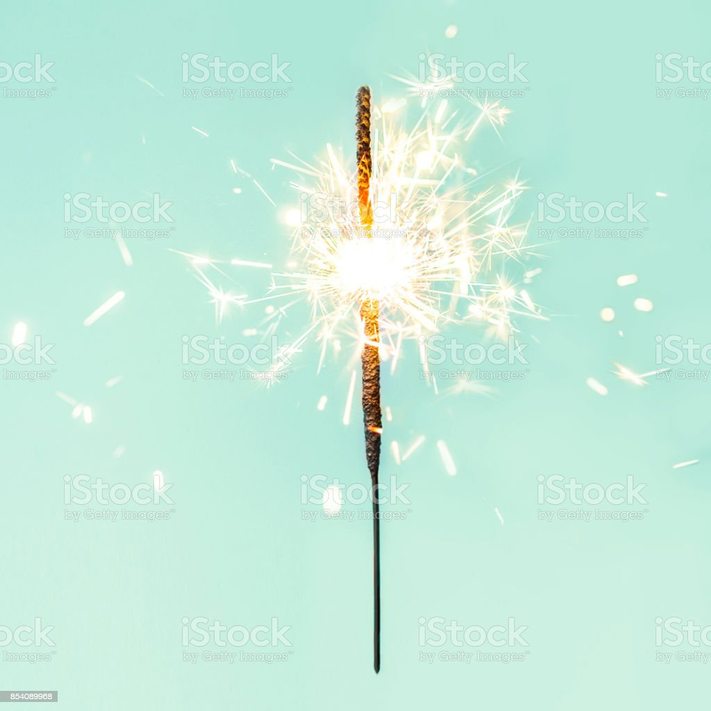 Festive Merry Christmas sparklers. Golden Magic lights for holiday poster, birthday or party concept. Sparkling beautiful sparkles or  bengal lights stock photo