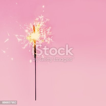 istock Festive Merry Christmas sparklers. Golden Magic  Sparkling beautiful card, sparkles or  bengal lights 886657952