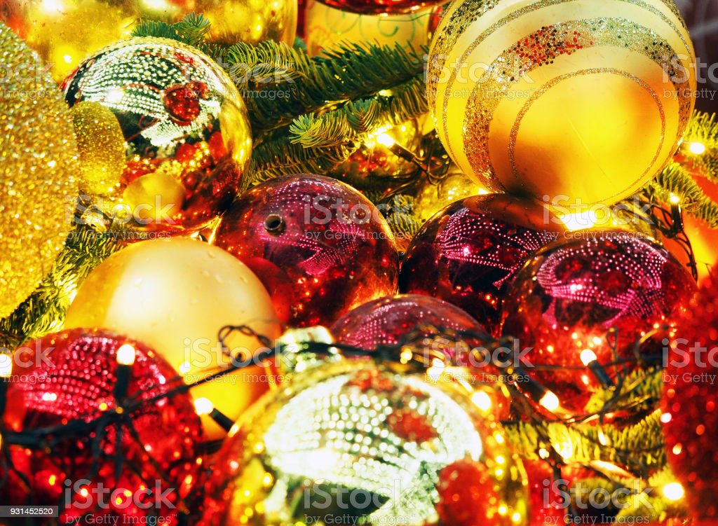 Festive New Year background, selective focus, Christmas tree garlands, balls and toys. Illumination stock photo
