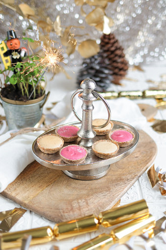 Festive Party Table with Dessert Cake Tarts for New Years