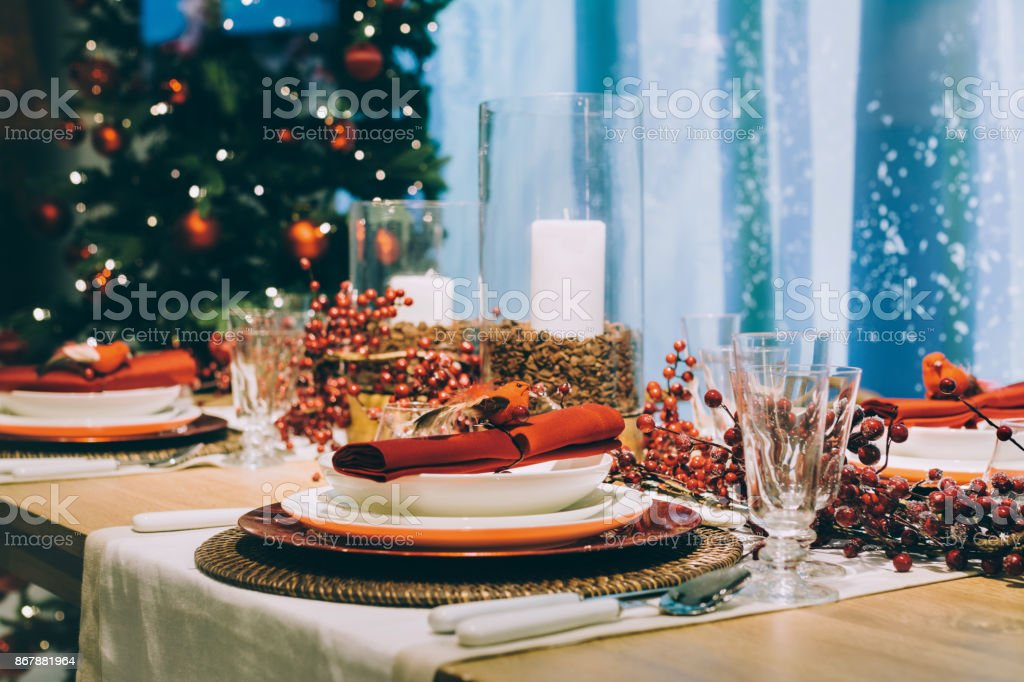 Festive place setting table, next to the Christmas tree stock photo