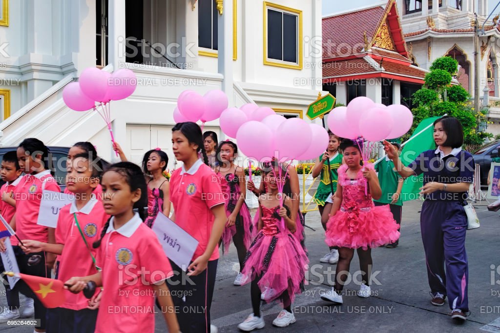Festive procession through the streets of the Bangkok, Thailand stock photo