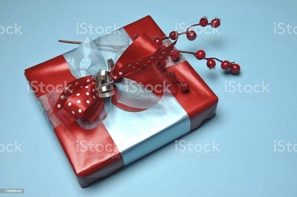 Festive red and pale blue gift with polka dot ribbon. royalty-free stock photo