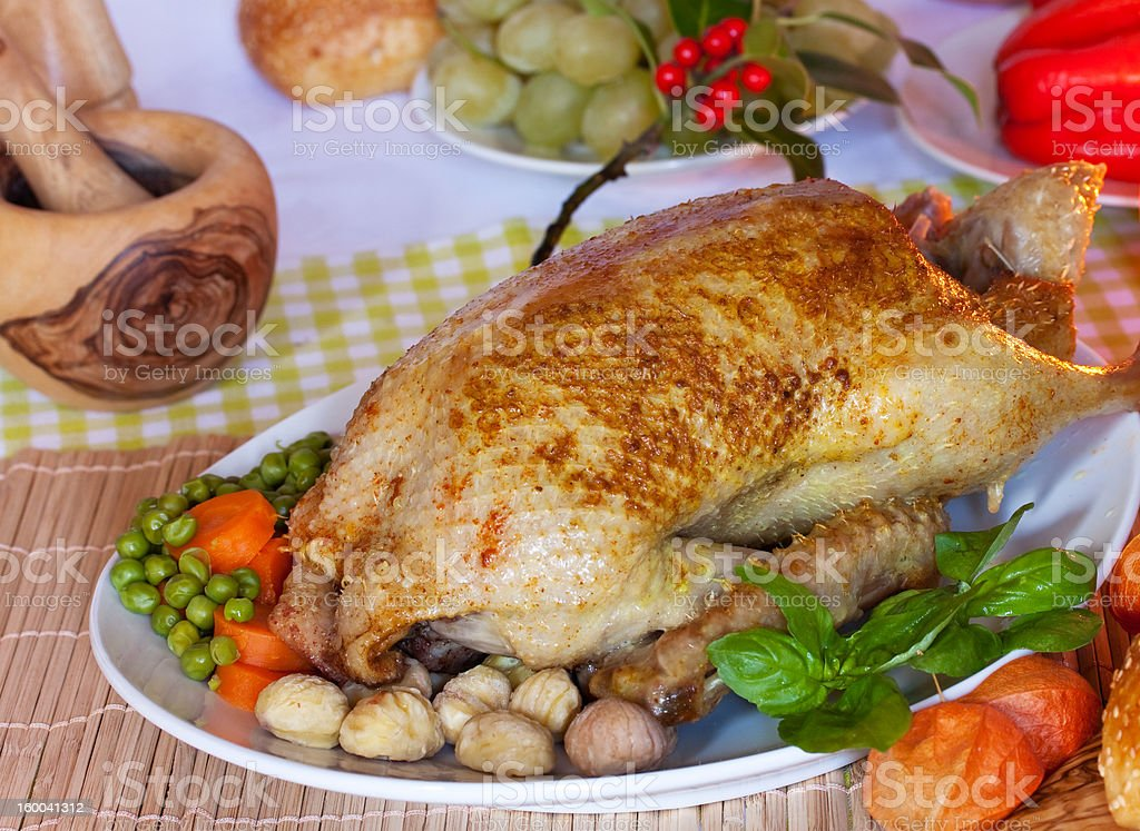 festive roast duck with carrot,pea and chestnuts royalty-free stock photo