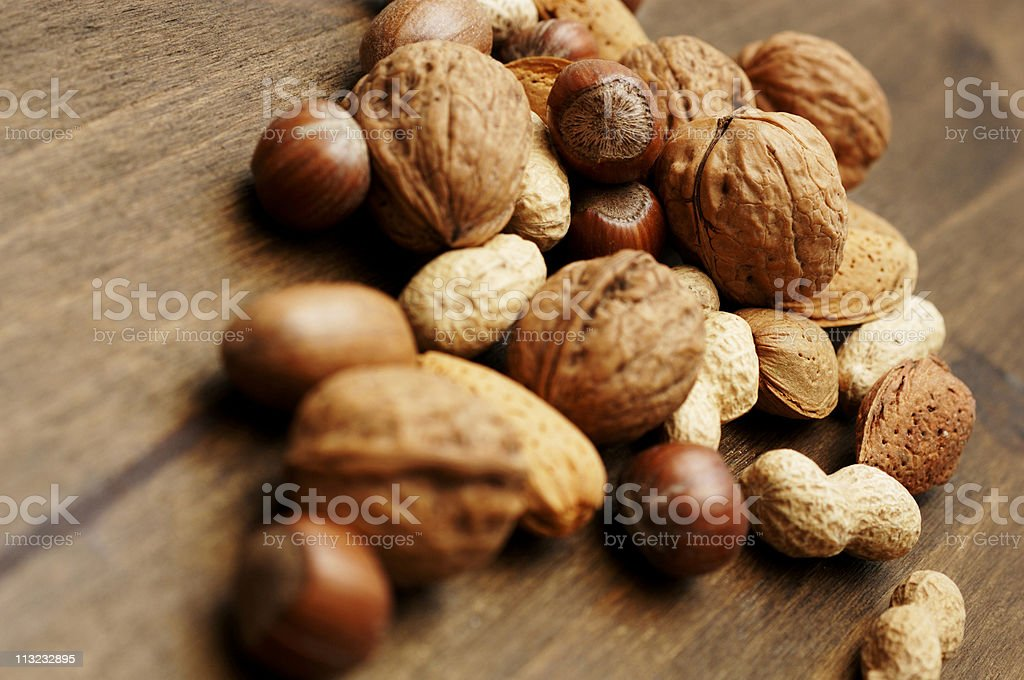 festive scene, mixed nuts against dark oak royalty-free stock photo