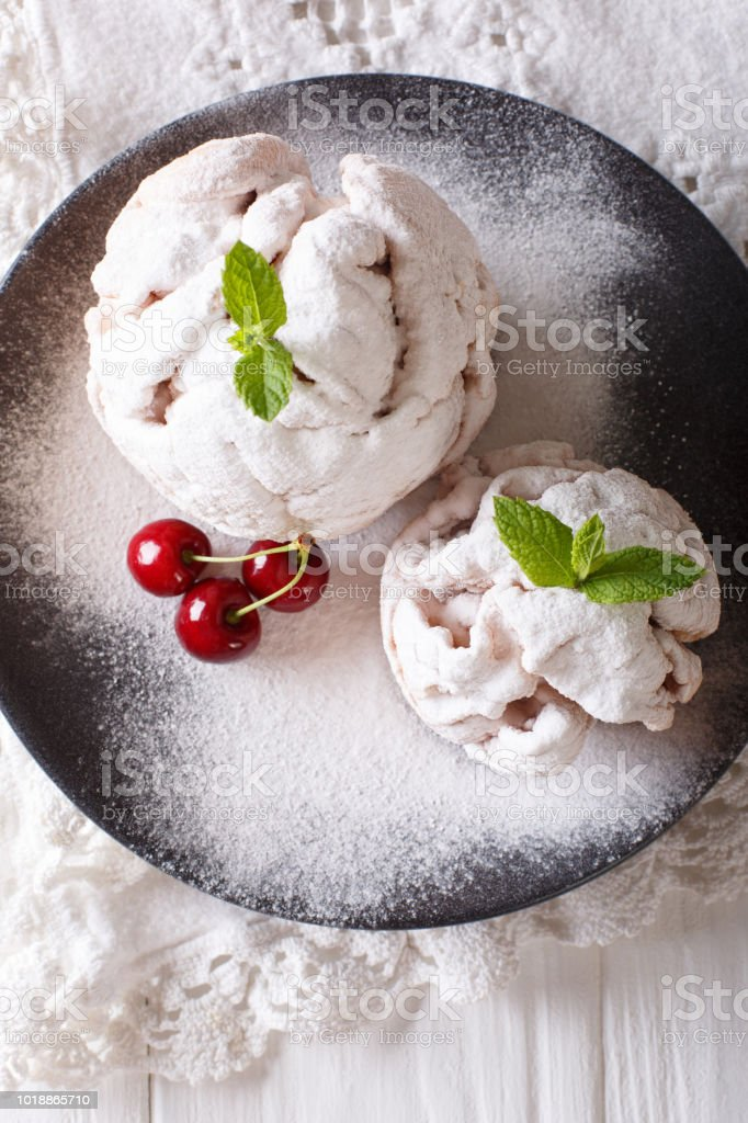 Festive Shortbread Cookie Snowball With Mint And Cherry On A Plate