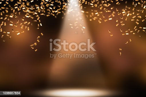 1051699126 istock photo festive shower of golden confetti 1038657834