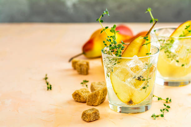 Festive summer drinks, pear thyme cocktail stock photo