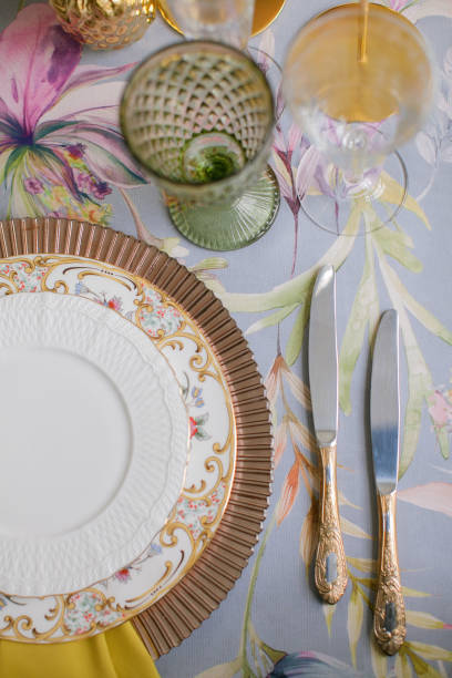 Festive table decor. Many pastel colors. Luxury wedding, party, birthday. Yellow berries. Copper chairs and dishes, gold and silver cutlery.  Chinese, European, chinoiserie style. Peonies and roses. Festive table decor. Many pastel colors. Luxury wedding, party, birthday. Yellow berries. Copper chairs and dishes, gold and silver cutlery.  Chinese, European, chinoiserie style. Peonies and roses. chinese wedding dinner stock pictures, royalty-free photos & images