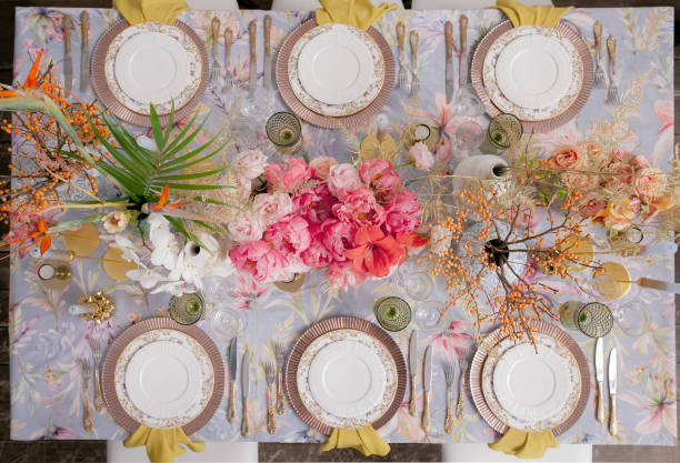Festive table decor. Pastel colors. Luxury wedding, party, birthday. Yellow berries. Copper chairs and dishes, gold and silver cutlery. Chinese, European, chinoiserie style. Peonies, roses. View above Festive table decor. Pastel colors. Luxury wedding, party, birthday. Yellow berries. Copper chairs and dishes, gold and silver cutlery. Chinese, European, chinoiserie style. Peonies, roses. View above chinese wedding dinner stock pictures, royalty-free photos & images