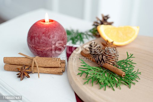 Festive table setting among winter decorations and a red candle. Top view, flat lay. The concept of Christmas or Thanksgiving family tea.
