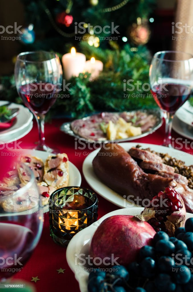 Festive table setting for holiday dinner with dishes at home....