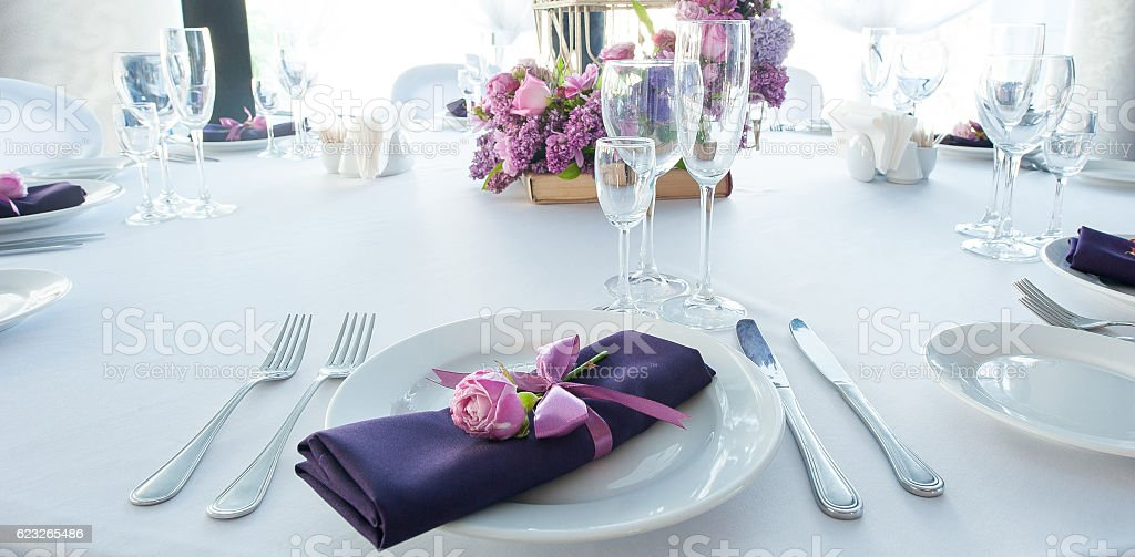Festive table setting in the restaurant with flowers. Wedding decor. stock photo