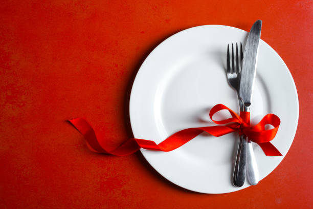 Festive table setting Festive table setting on a red background. Concept Valentine's Day. table for two stock pictures, royalty-free photos & images