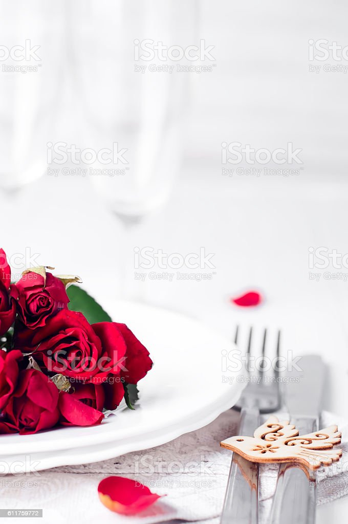Festive table setting with beige roses stock photo