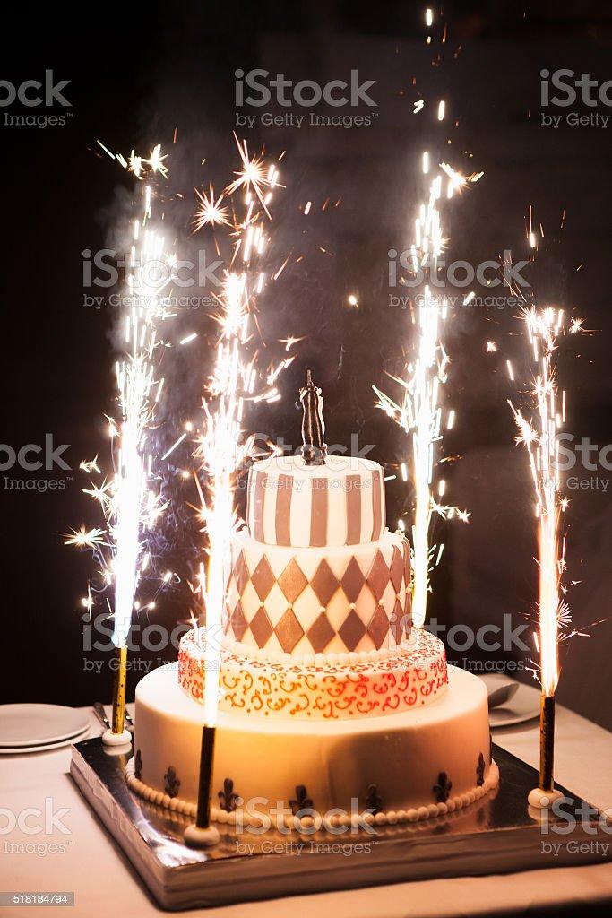 Festive wedding cake with fireworks on a dark background stock photo