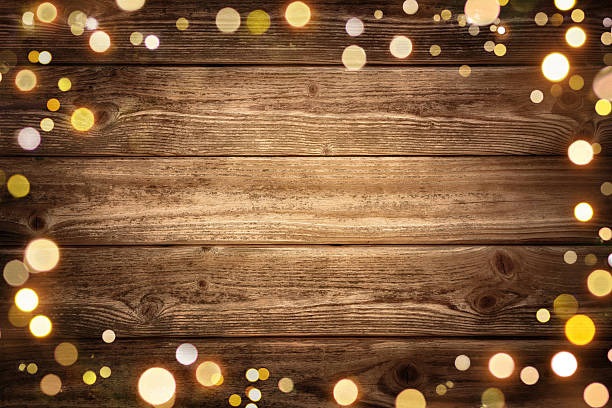 Festive wooden background with lights stock photo