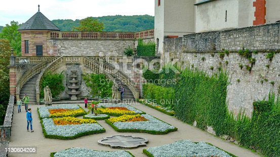 Würzburg, Germany - September 3, 2014: Tourists walk through the garden of the Fortress Marienberg in Würzburg.